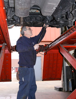 technician providing car maintenance service
