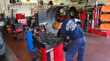 Hollenshades technician servicing car tires